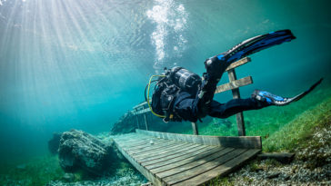 Crossing a bridge in the underwater park in austria